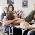 Male high school student asleep in class --- Image by © Image Source/Corbis
