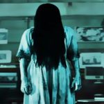 Mystical ghost woman in white shirt with long black hair isolated